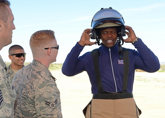 Actor Terry Crews gets to put on a bomb-protection suit and helmet with the help of Airmen from the 812th Civil Engineering Squadron, Explosive Ordnance Disposal Flight, Feb. 24.  (U.S. Air Force photo by Kenji Thuloweit)