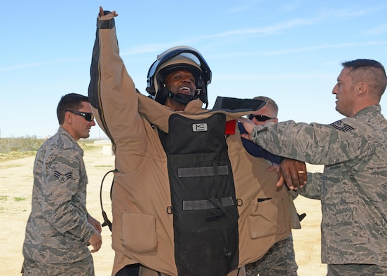 Actor Terry Crews gets to put on a bomb-protection suit with the help of Airmen from the 812th Civil Engineering Squadron, Explosive Ordnance Disposal Flight, Feb. 24.  (U.S. Air Force photo by Kenji Thuloweit)