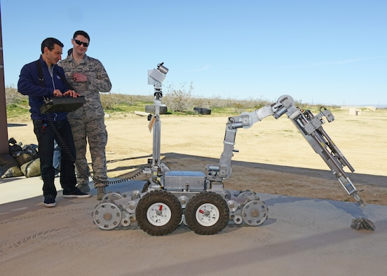 """Ultimate Beastmaster"" executive producer David Broome, operates a robot from the 812th Civil Engineering Squadron, Explosive Ordnance Disposal Flight, with the guidance of a bomb technician Feb. 24.  (U.S. Air Force photo by Kenji Thuloweit)"
