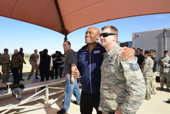 "Mixed martial arts fighter Anderson Silva poses for photos with Airmen Feb. 24. Silva is one of the hosts of a new Netflix show called the ""Ultimate Beastmaster."" (U.S. Air Force photo by Kenji Thuloweit)"