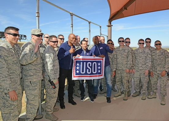 "Middle, from left to right: Mixed martial arts fighter Anderson Silva; executive producer David Broome; and actor Terry Crews, pose with Airmen of the 812th Civil Engineering Squadron, Explosive Ordnance Disposal Flight Feb. 24. The celebrity trio were brought to Edwards Air Force Base to debut a new Netflix show called the ""Ultimate Beastmaster."" (U.S. Air Force photo by Kenji Thuloweit)"