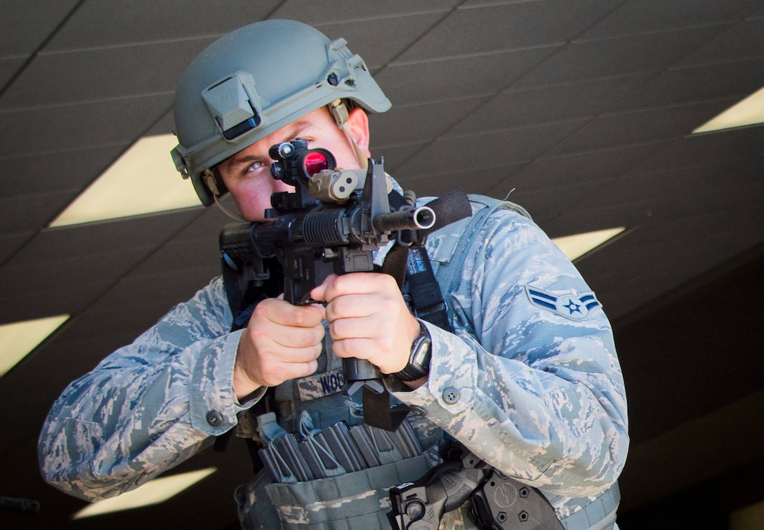 Airman 1st Class Wolford, 96th Security Forces Squadron, stands guard after clearing a building during an exercise at the 7th Special Forces Group (A) compound Feb. 23 at Eglin Air Force Base, Fla. The simulated detonation scenario tested firefighters, security forces and medical emergency response personnel agencies among others. (U.S. Air Force photo/Ilka Cole)