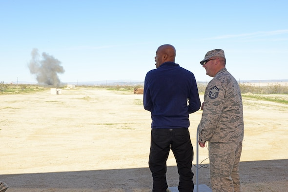 Mixed martial arts fighter Anderson Silva reacts after detonating a small amount of explosives with the help of an Airman from the 812th Civil Engineering Squadron, Explosive Ordnance Disposal Flight, Feb. 24. (U.S. Air Force photo by Kenji Thuloweit)