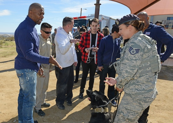 "Actor and ""Ultimate Beastmaster"" host Terry Crews talks with Staff Sgt. Grace Daniels, 412th Security Forces Squadron, following a military working dog demonstration Feb. 24. (U.S. Air Force photo by Kenji Thuloweit)"