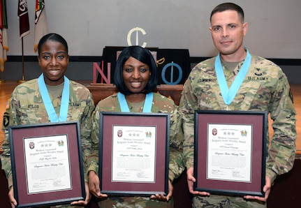Staff Sgt. Magalie Atilus, Sgt. 1st Class Debbie Laster and Sgt. 1st Class Daniel Cummings pose with their inductions certificates for the Sergeant Major of the Army Leon L. Autreve Chapter of the Sergeant Audie Murphy Club at a ceremony at the Evans Theater at Joint Base San Antonio-Fort Sam Houston March 1. All three Soldiers are members of the 32nd Medical Brigade.