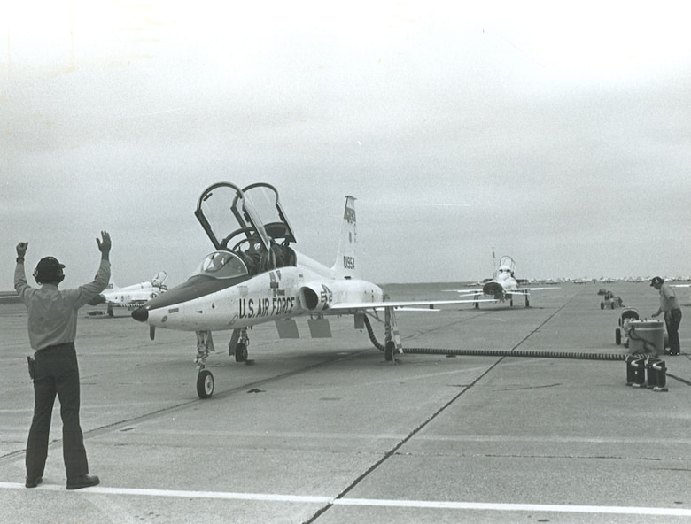 A maintainer marshalls a T-38C Talon on the flightline on Laughlin Air Force Base, Texas, in 1989. (Courtesy photo)