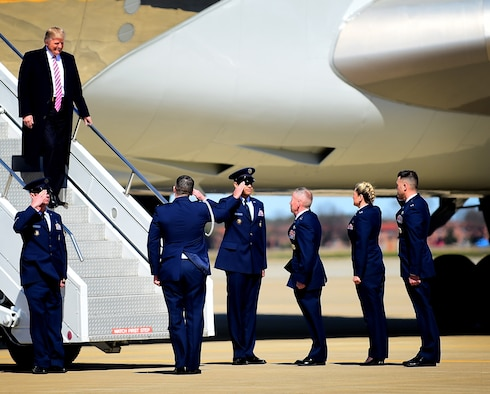 President Donald J. Trump is greeted by Maj. Gen. John K. McMullen, vice commander, Air Combat Command, Col. Caroline Miller, 633rd Air Base Wing commander, and Col. Peter Fesler, 1st Fighter Wing commander at Joint Base Langley-Eustis, Va., March 2, 2017. The 633rd ABW is the host wing to 24,000 Airmen, Soldiers and civilians who support 11 major units, one of which is the 1st FW, whose mission is to deliver stealth, combat airpower world-wide on short notice to combatant commanders. (U.S. Air Force photo by Senior Airman Areca T. Bell)
