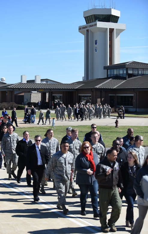 Service members and their families make their way to the Langley Air Force Base flightline to greet U.S. President Donald J. Trump at Joint Base Langley-Eustis, Va., March 2, 2016. The president arrived and departed from the flight line of the 1st Fighter Wing, the U.S. Air Force's premiere air dominance wing led by next generation Airmen, who fly, maintain and support one third of the U.S. Air Force's combat F-22 Raptors.  (U.S. Air Force photo by Staff Sgt. Natasha Stannard)