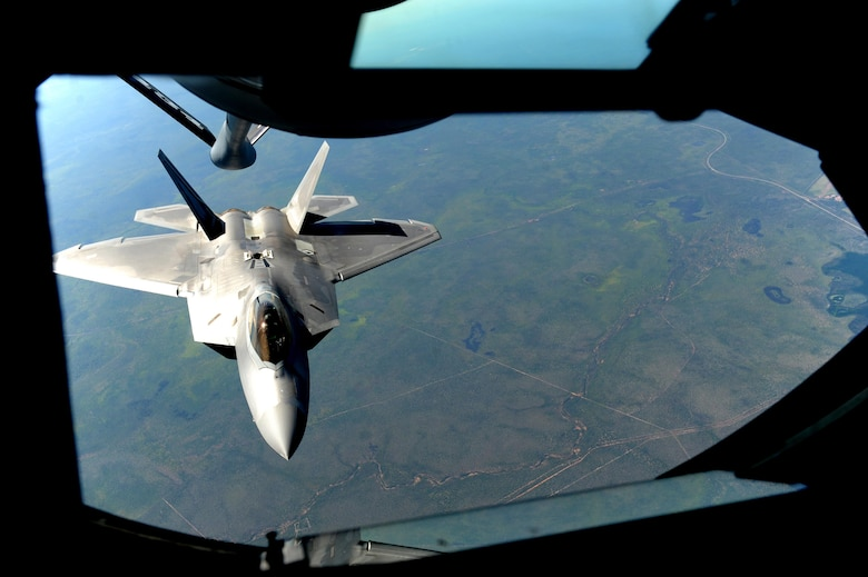 A U.S. Air Force F-22 Raptor assigned to the 90th Fighter Squadron approaches a U.S. Air Force KC-135 Stratotanker in order to receive fuel in the skies above Royal Australian Air Force Base Tindal, Australia, March 2, 2017. Twelve F-22 Raptors and approximately 200 U.S. Air Force Airmen participated in the first Enhanced Air Cooperation, an initiative under the Force Posture Agreement between the U.S. and Australia. (U.S. Air Force photo by Staff Sgt. Alexander Martinez)