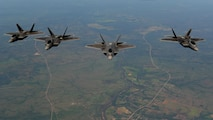 Four U.S. Air Force F-22 Raptors assigned to the 90th Fighter Squadron fly in formation in the skies above Royal Australian Air Force Base Tindal, Australia, March 2, 2017. Twelve F-22 Raptors and approximately 200 U.S. Air Force Airmen participated in the first Enhanced Air Cooperation, an initiative under the Force Posture Agreement between the U.S. and Australia. (U.S. Air Force photo by Staff Sgt. Alexander Martinez)