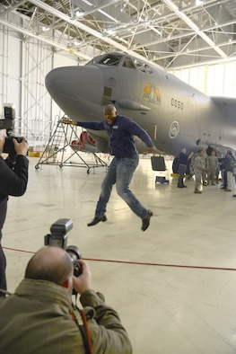 Actor Terry Crews jumps at the chance for photos while visiting Hangar 1600 Feb. 24. (U.S. Air Force photo by Christopher Ball)