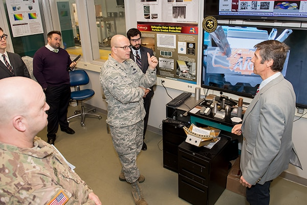 Defense Logistics Agency Aviation Commander Air Force Brig. Gen. Allan Day talks with Victor Champagne, U.S. Army Research Laboratory's Advanced Materials and Processes team leader, during a facilities tour at Aberdeen Proving Ground, Maryland, Feb. 23, 2017.