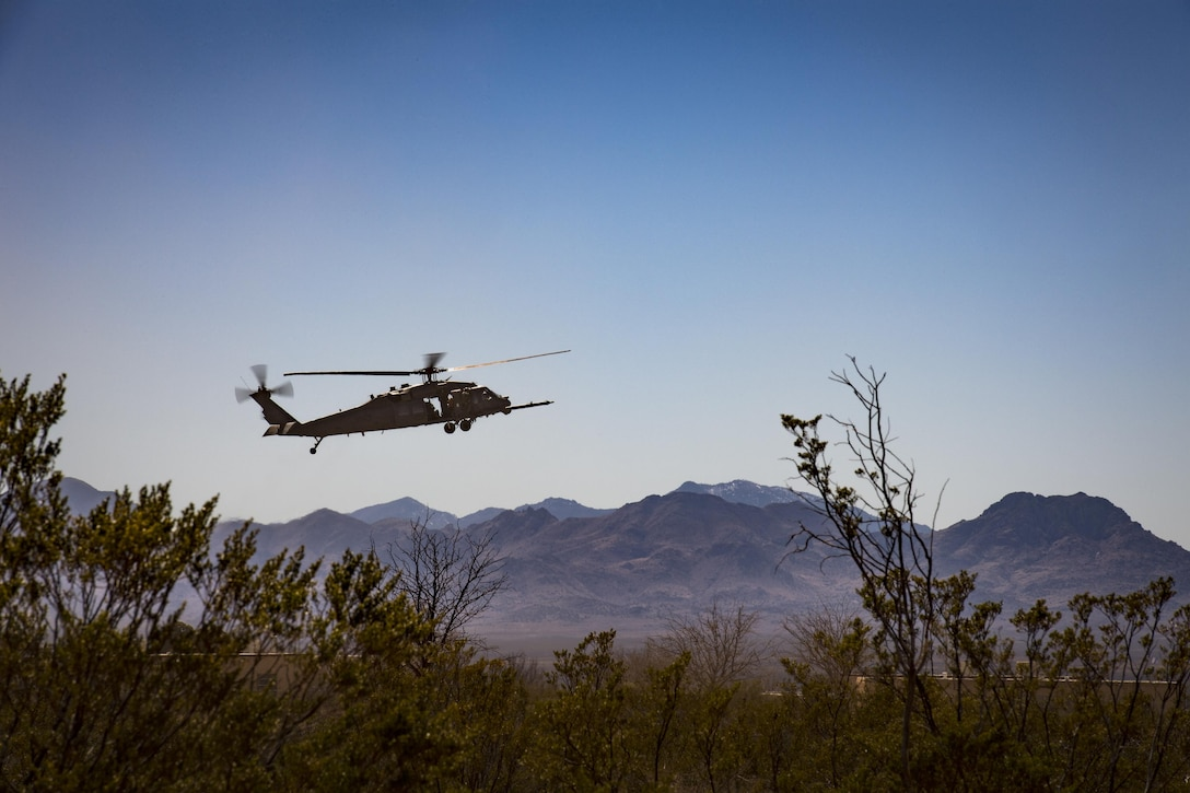 An HH-60G Pave Hawk descends to land in support of a U.S. Air Force and Marine joint exercise as part of a simulated Tactical Recovery of Aircraft and Personnel scenario, Feb 22, 2017, at the Playas Training and Research Center, N.M. During the scenario, Marines from I Marine Expeditionary Force from Marine Corps Base Camp Pendleton, Calif., rescued isolated personnel from a downed aircraft while fending off mock opposition forces from Davis-Monthan Air Force Base, Ariz.'s 563d Operations Support Squadron. This joint effort prepared the IMEF by completing their Special Purpose Marine Air Ground Task Force certification. This is the culmination of their crisis response operations before deploying to the United States Central Command, which consists of 20 countries In Northeast Africa and Southwest Asia. (U.S. Air Force photo by Staff Sgt. Ryan Callaghan)