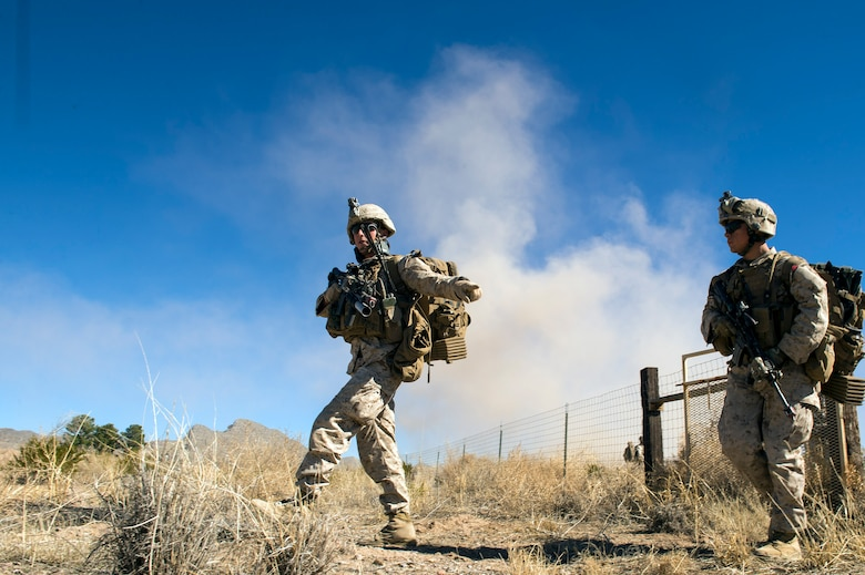 Members of the I Marine Expeditionary Force from Marine Corps Base Camp Pendleton, Calif., advance the desert during a simulated Tactical Recovery of Aircraft and Personnel scenario, Feb 22, 2017, at the Playas Training and Research Center, N.M. During the scenario, the IMEF rescued isolated personnel from a downed aircraft while fending off mock opposition forces from Davis-Monthan Air Force Base, Ariz.'s 563d Operations Support Squadron. This joint effort prepared the IMEF by completing their Special Purpose Marine Air Ground Task Force certification. This is the culmination of their crisis response operations before deploying to the United States Central Command, which consists of 20 countries In Northeast Africa and Southwest Asia. (U.S. Air Force photo by Airman 1st Class Greg Nash)
