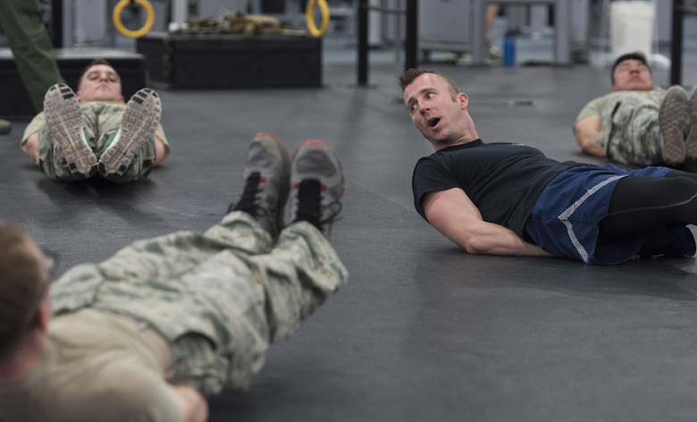 """Staff Sgt. Brian Sollis, 811th Security Forces Squadron executive aircraft security member and instructor, leads an exercise during Fly-Away Security Team training, nicknamed """"Pre-Raven,"""" at Joint Base Andrews, Md., Feb. 24, 2017. This quarterly-held course determines whether applicants can perform the Raven mission of providing discrete, low‐visibility security that ensures protection for Air Force aircraft transiting airfields where security is unknown or deemed inadequate to counter local threats. This includes training in the realm of teamwork, leadership, legal considerations, Redman qualification fights, baton maneuvers and verbal judo. (U.S. Air Force photo by Senior Airman Jordyn Fetter)"""