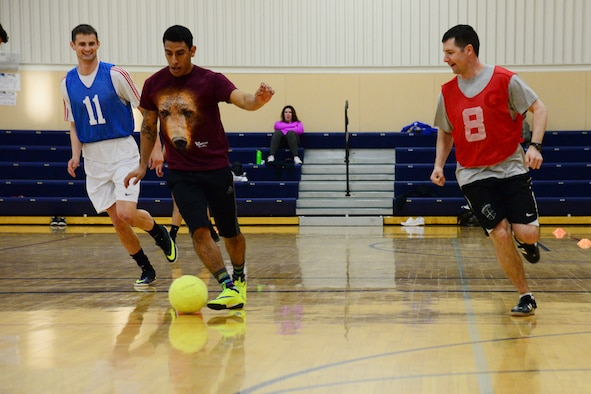 Maj. Jeremiah Kirschman, 341st Contracting Squadron commander, number eight, plays soccer with Airmen Feb. 24, 2017, at Malmstrom Air Force Base, Mont. The fitness center is hosting indoor soccer every Friday 5-7 p.m. at the basketball courts. (U.S. Air Force photo/Airman 1st Class Magen. M. Reeves)