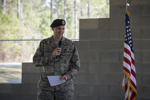 Maj. Charles Tenney, 23d Security Forces Squadron commander, shares memories about military working dog Ssmokey during a MWD leash transfer ceremony, Feb. 28, 2017, at Moody Air Force Base, Ga. Ssmokey was transferred from the care of Staff Sgt. Jason Ashmore, 23d SFS MWD trainer, to Officer Jose Cruz, VPD K-9 handler, where he will continue his work as an explosive detective dog in the local community. (U.S. Air Force photo by Airman 1st Class Lauren M. Sprunk)