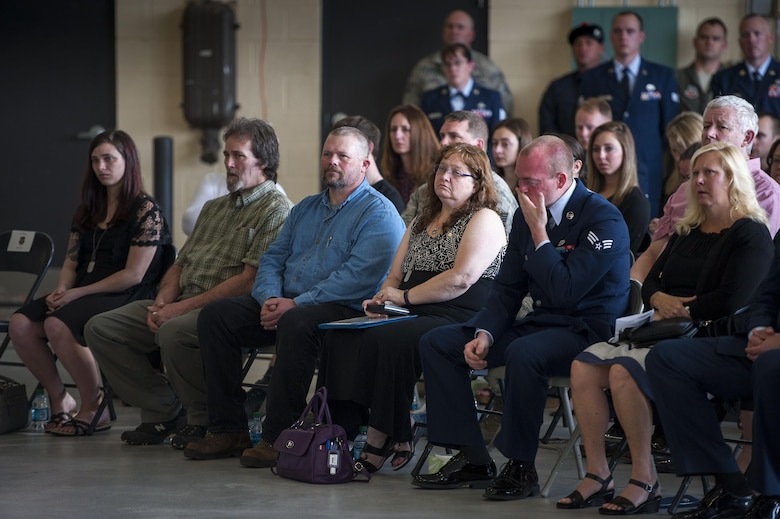 Family of the late Staff Sgt. Sara Toy, 74th Aircraft Maintenance Unit weapons team chief, reflect during a memorial ceremony, March 1, 2017, at Moody Air Force Base, Ga. Toy, a New Kent, Virginia native, died in a car accident Feb. 25, 2017. During the ceremony, she was remembered as a valuable member of the Team Moody weapons community and was posthumously awarded the Air Force Commendation Medal and the rank of Staff Sergeant. (U.S. Air Force photo by Andrea Jenkins/Released)