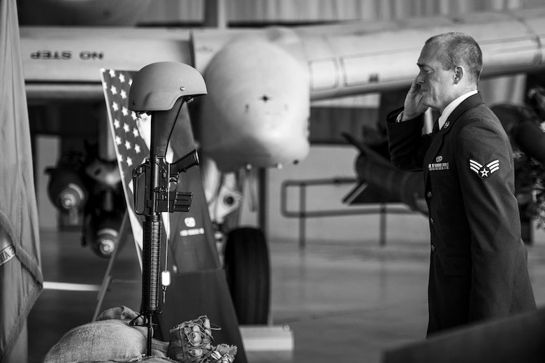 Senior Airman Lucus Zeman, 23d Equipment Maintenance Squadron, renders a final salute to a battlefield cross during a memorial ceremony in honor of his late wife, Staff Sgt. Sara Toy, 74th Aircraft Maintenance Unit weapons team chief, March 1, 2017, at Moody Air Force Base, Ga. Toy, a New Kent, Virginia native, died in a car accident Feb. 25, 2017. During the ceremony, she was remembered as a valuable member of the Team Moody weapons community and was posthumously awarded the Air Force Commendation Medal and the rank of Staff Sergeant. (U.S. Air Force photo by Andrea Jenkins/Released)