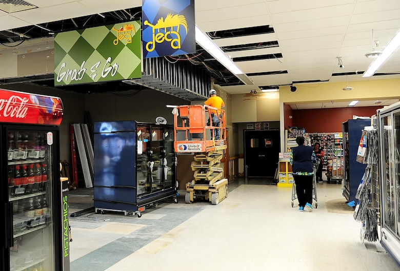 The old Commissary bread section is emptied and the surrounding walls have been removed March 1, 2017, at Columbus Air Force Base, Mississippi. The location has been marked as the new permanent location of the sushi bar, the Grab and Go drink and sandwich coolers, and a brand new rotisserie chicken stand, right outside the self-checkouts. (U.S. Air Force photo by Senior Airman Kaleb Snay)