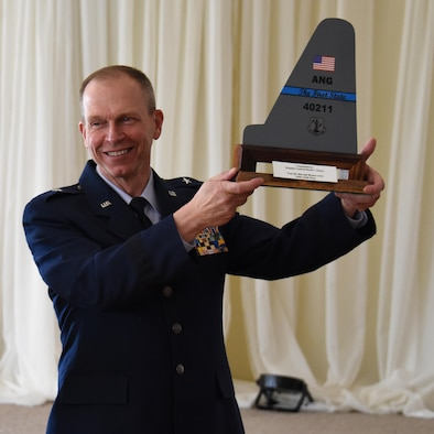 NEWARK, De.- Brig. Gen. David E. Deputy, chief of staff, Delaware National Guard, holds up a tail flash presented by Col. David B. Walker, assistant adjutant general-air, Delaware National Guard, during a luncheon held at the Cavalier Country Club, as a symbol of appreciation for over forty years of service in the Delaware Air National Guard. (U.S. Air National Guard photo by Tech. Sgt. Gwendolyn Blakley\ Released).