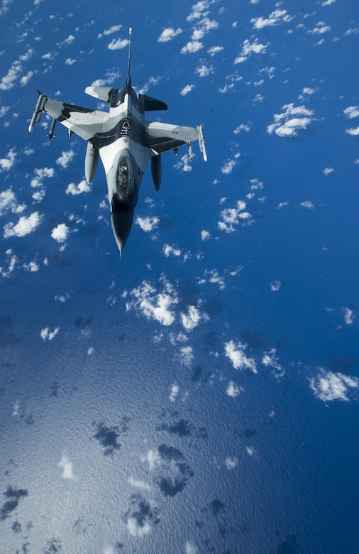 A U.S. Air Force F-16 Fighting Falcon assigned to the 18th Aggressor Squadron makes it way to recieve in-flight fuel from a U.S. Air Force KC-135 Stratotanker during Cope North 17, March 2, 2017. The exercise includes 22 total flying units and more than 2,700 personnel from three countries and continues the growth of strong, interoperable relationships within the Indo-Asia-Pacific region through integration of airborne and land-based command and control assets. (U.S. Air Force photo by Staff Sgt. Keith James)