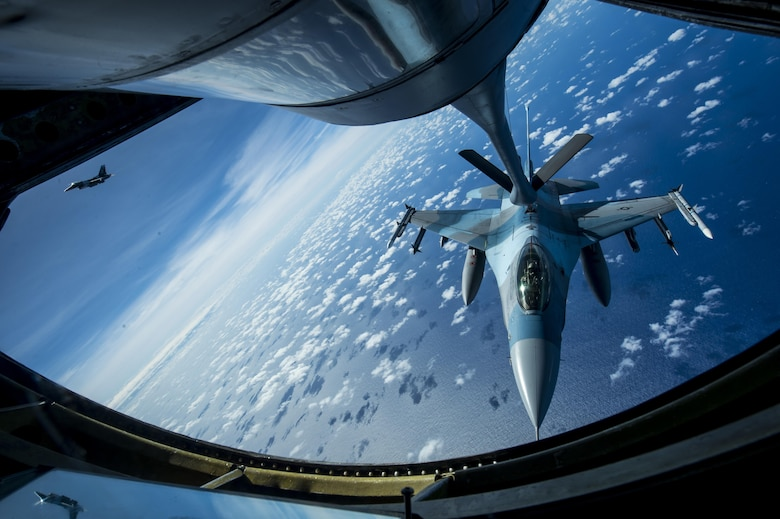U.S. Air Force F-16 Fighting Falcons assigned to the 18th Aggressor Squadron receives in-flight fuel from a U.S. Air Force KC-135 Stratotanker during Cope North 17, March 2, 2017. The exercise includes 22 total flying units and more than 2,700 personnel from three countries and continues the growth of strong, interoperable relationships within the Indo-Asia-Pacific region through integration of airborne and land-based command and control assets. (U.S. Air Force photo by Staff Sgt. Keith James)