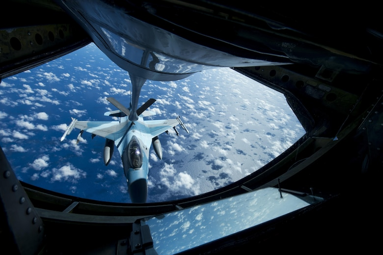 A U.S. Air Force F-16 Fighting Falcon assigned to the 18th Aggressor Squadron receives in-flight fuel from a U.S. Air Force KC-135 Stratotanker during Cope North 17, March 2, 2017. The exercise includes 22 total flying units and more than 2,700 personnel from three countries and continues the growth of strong, interoperable relationships within the Indo-Asia-Pacific region through integration of airborne and land-based command and control assets. (U.S. Air Force photo by Staff Sgt. Keith James)
