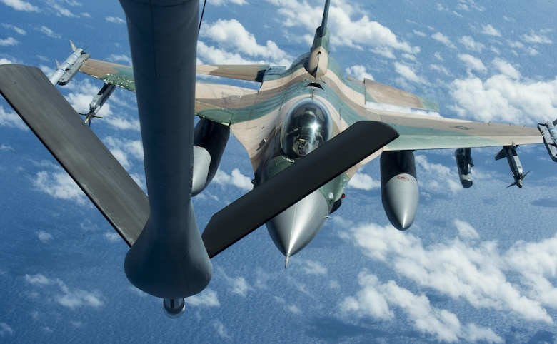 A U.S. Air Force F-16 Fighting Falcon assigned to the 18th Aggressor Squadron approaches a U.S. Air Force KC-135 Stratotanker to receive in-flight fuel during Cope North 17, March 2, 2017. The exercise includes 22 total flying units and more than 2,700 personnel from three countries and continues the growth of strong, interoperable relationships within the Indo-Asia-Pacific region through integration of airborne and land-based command and control assets. (U.S. Air Force photo by Staff Sgt. Keith James)