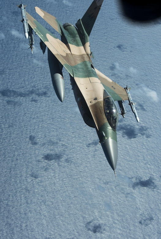 A U.S. Air Force F-16 Fighting Falcon assigned to the 18th Aggressor Squadron banks left after recieving in-flight fuel from a U.S. Air Force KC-135 Stratotanker during Cope North 17, March 2, 2017. The exercise includes 22 total flying units and more than 2,700 personnel from three countries and continues the growth of strong, interoperable relationships within the Indo-Asia-Pacific region through integration of airborne and land-based command and control assets. (U.S. Air Force photo by Staff Sgt. Keith James)