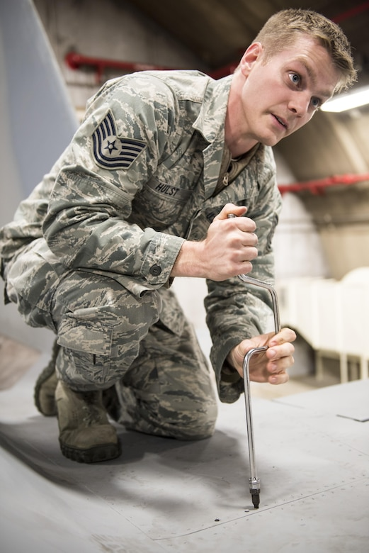 U.S. Air Force Tech. Sgt. Michael Hust, 44th Aircraft Maintenance Unit lead electrical and environmental specialist, demonstrates how to remove a panel from an F-15A Eagle Feb. 28, 2017, at Kadena Air Base, Japan. Hust helps instruct new electrical and environmental maintainers for the 18th Maintenance Training Flight's new ENE core tasks course. (U.S. Air Force photo by Senior Airman Omari Bernard/Released)