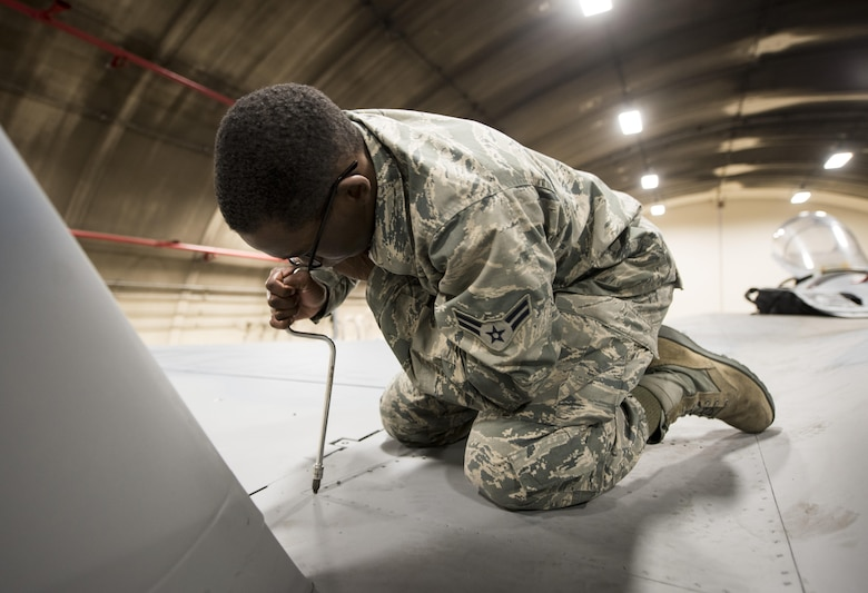 U.S. Air Force Airman 1st Class Emon Kizer, 18th Component Maintenance Squadron electrical and environmental apprentice, practices removing a panel on an F-15A Eagle Feb. 28, 2017, at Kadena Air Base, Japan. Kizer is attending the 18th Maintenance Training Flight's new ENE core tasks course. (U.S. Air Force photo by Senior Airman Omari Bernard/Released)