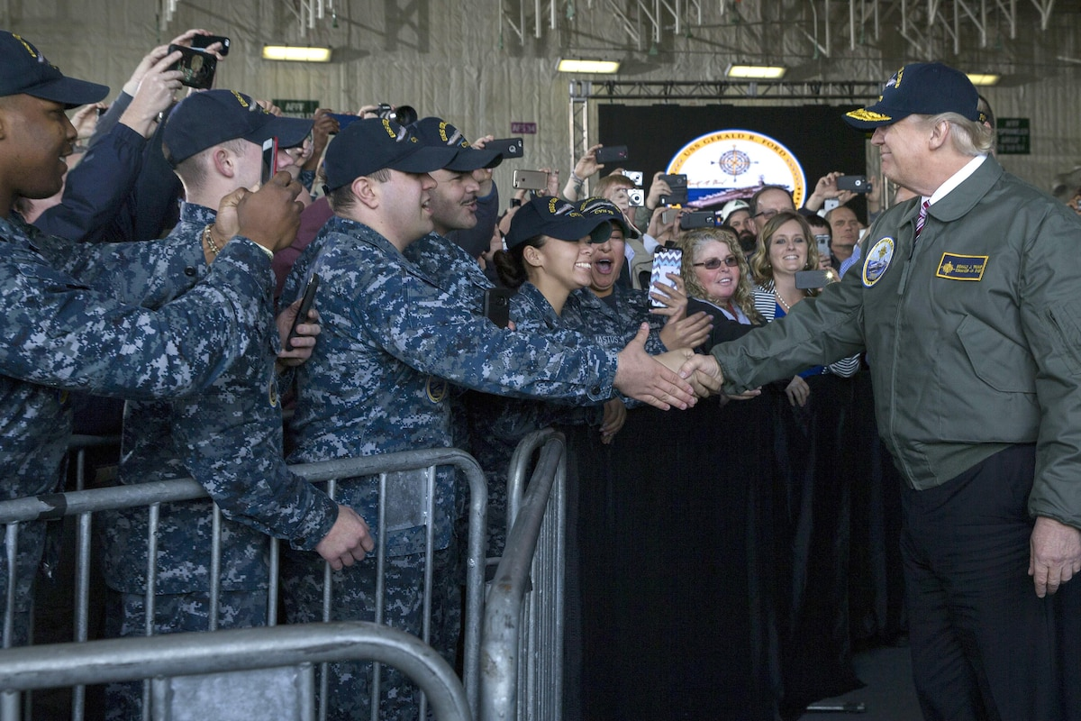 President Donald J. Trump greets sailors aboard the Navy's newest aircraft carrier.