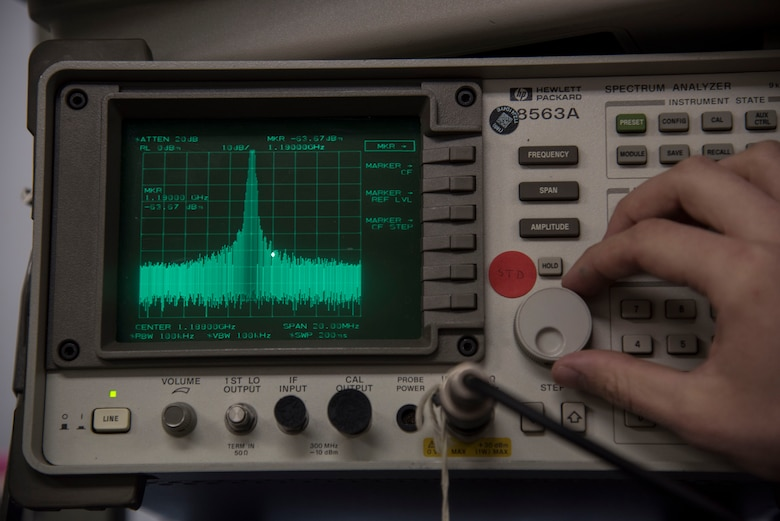 U.S. Air Force Airman 1st Class Tristan Blake, a 35th Operations Support Squadron airfield systems technician, dials a spectrum analyzer at Misawa Air Base, Japan, Feb. 27, 2017. The spectrum analyzer ensures tactical air navigation system power stays on the correct frequency. The machine also displays various nearby frequencies for Airmen to monitor. (U.S. Air Force photo by Airman 1st Class Sadie Colbert)