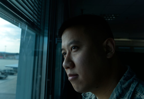 Staff Sgt. Srun Sookmeewiriya, 313th Expeditionary Operations Support Squadron NCO in charge of reports, stares out the window of his work center on Ramstein Air Base, Germany, Feb. 16, 2017. Sookmeewiriya attempted suicide twice after the death of both his parents. He now shares his story in an effort to help Airmen open up about struggles and bounce back from their challenges. (U.S. Air Force photo by Airman 1st Class Joshua Magbanua)