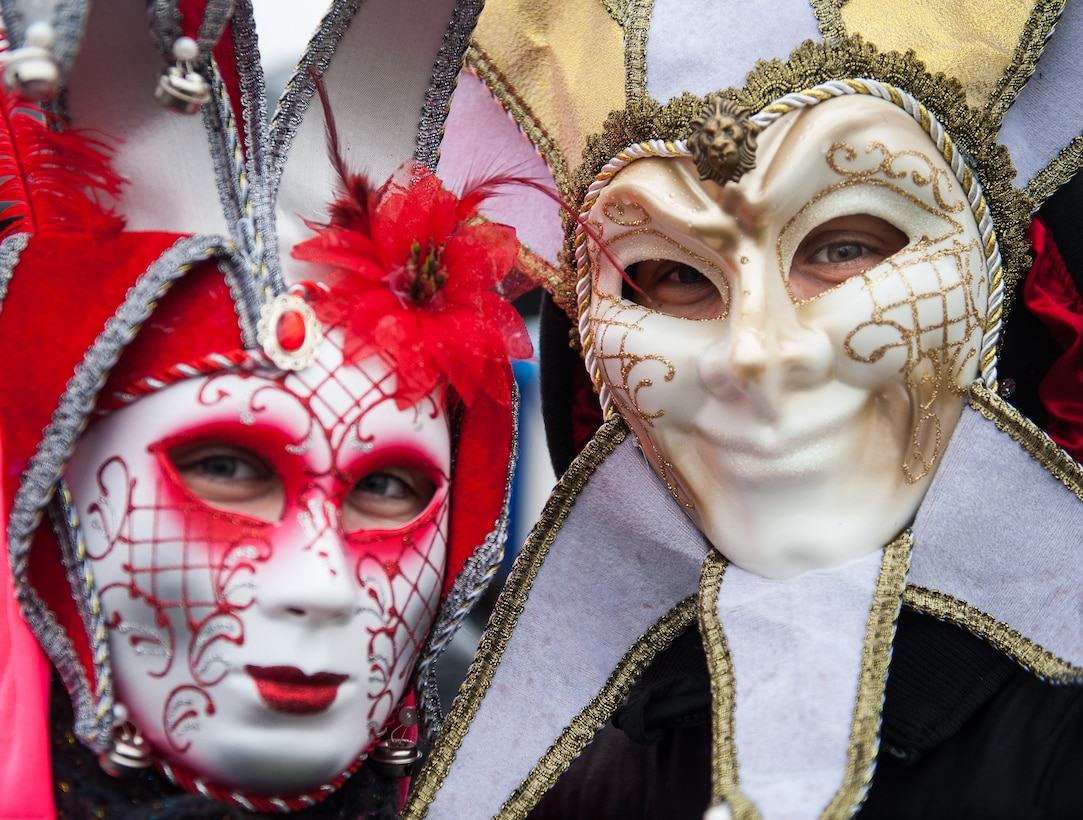 Two masqueraded people pose for a photo during fasching, a festival held across Europe, in the city of Ramstein, Germany, Feb. 28, 2017. Fasching is a time of festivity and merry making—a time where common place people take a chance to free themselves for personal expression and celebration. (U.S. Air Force photo by Senior Airman Lane T. Plummer)