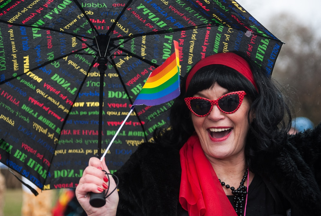 A woman waves a rainbow flag during fasching, a festival held across Europe, in the city of Ramstein, Germany, Feb. 28, 2017. The festival has been recognized and celebrated since the 13th century. Written records show the first carnival was held in 1341 in Köln, Germany. (U.S. Air Force photo by Senior Airman Lane T. Plummer)