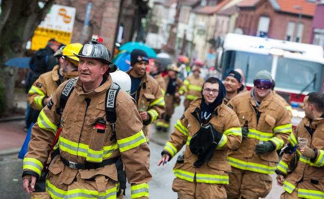 Firefighters from the Ramstein Air Base fire department walk through a parade during fasching, a festival held across Europe, in the city of Ramstein, Germany, Feb. 28, 2017. Civil workers, politicians, businessmen and more come together to crowd their streets and celebrate the coming of warmer weather. (U.S. Air Force photo by Senior Airman Lane T. Plummer)