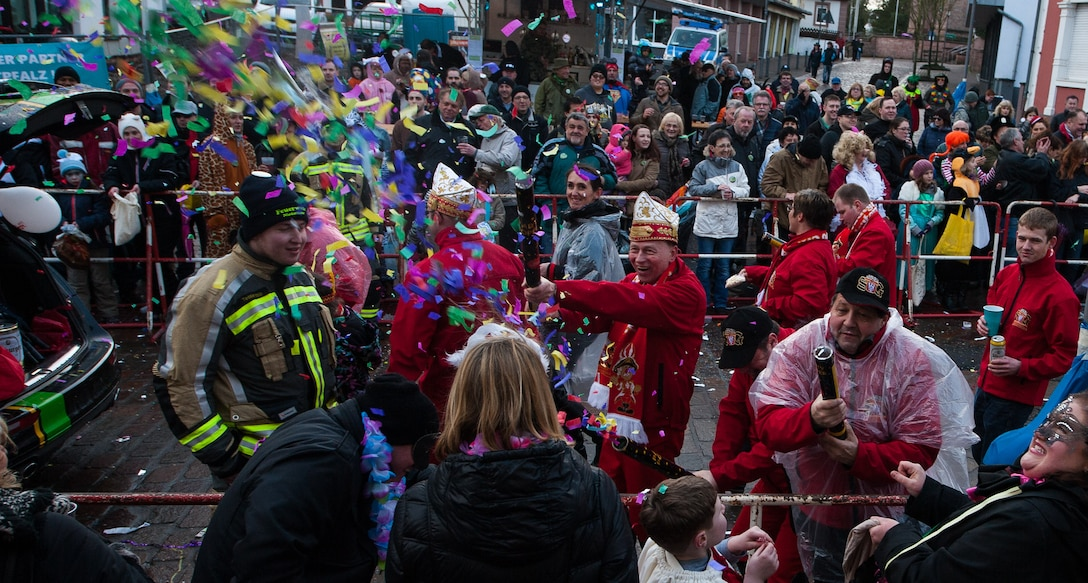 A man blasts pieces of colored paper at a crowd during fasching, a festival held across Europe, in the city of Ramstein, Germany, Feb. 28, 2017. Fasching is Germany's carnival season. It starts on the 11th day of November at exactly 11 minutes after 11 am and ends at the stroke of midnight on Shroud Tuesday—often referred to as Fat Tuesday. (U.S. Air Force photo by Senior Airman Lane T. Plummer)