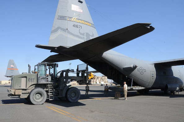737th Expeditionary Airlift Squadron Airmen load a C-130H Hercules at an undisclosed location in Southwest Asia Feb. 8, 2017.  The mission of the 737th is to deliver personnel and cargo downrange in support of Operation Inherent Resolve. (U.S. Air Force photo/Tech. Sgt. Kenneth McCann)