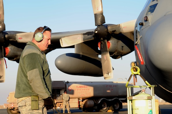 Staff Sgt. Michael Beaver, 737th Expeditionary Air Squadron crew chief, watches over a C-130 Hercules as it gets fueled Feb. 8, 2017 at an undisclosed location in Southwest Asia. The mission of the 737th is to deliver personnel and cargo downrange in support of Operation Inherent Resolve. (U.S. Air Force photo/Tech. Sgt. Kenneth McCann)