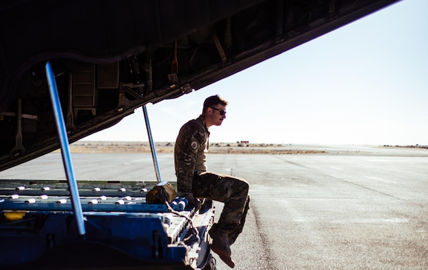 U.S. Air Force Staff Sgt. Nick Barth, 737th Expeditionary Airlift Squadron loadmaster, waits for the remainder of the crew he is flying with to complete preflight checks for a C-130 Hercules before take-off at an undisclosed location in Southwest Asia, Feb. 4, 2017. Barth was part of a team that delivered thousands of pounds in supplies to aid in the fight against Islamic State of Iraq and the Levant and Mosul offensive. (U.S. Air Force photo by Senior Airman Jordan Castelan)