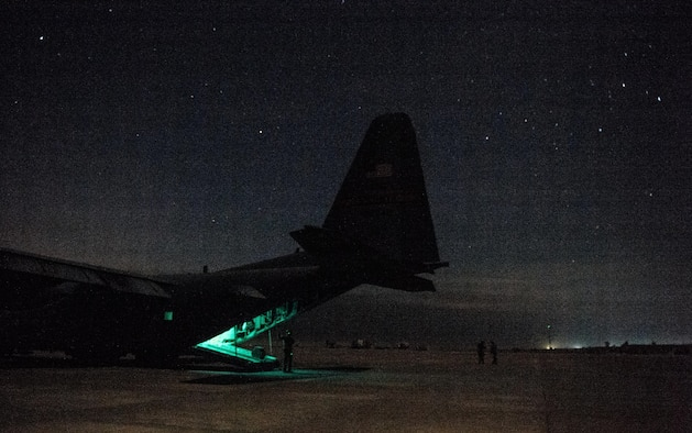 U.S. Air Force Staff Sgt. Nick Barth, 737th Expeditionary Airlift Squadron loadmaster, finishes unloading a C-130 Hercules at Qayyarah West Airfield , Iraq, Feb. 4, 2017. Barth was part of a team that delivered thousands of pounds in supplies to aide in the fight against the Islamic State of Iraq and the Levant and Mosul offensive. (U.S. Air Force photo by Senior Airman Jordan Castelan)