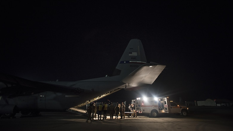Members of the 455th Expeditionary Aeromedical Evacuation Squadron carry a patient from a C-130J Hercules to a waiting ambulance at Bagram Airfield, Afghanistan, Feb. 22, 2017. Patients are at their most vulnerable while being transported, so aeromedical evacuation technicians are trained in providing continuous stabilization, advanced care and life-saving intervention techniques in flight. (U.S. Air Force photo by Staff Sgt. Katherine Spessa)