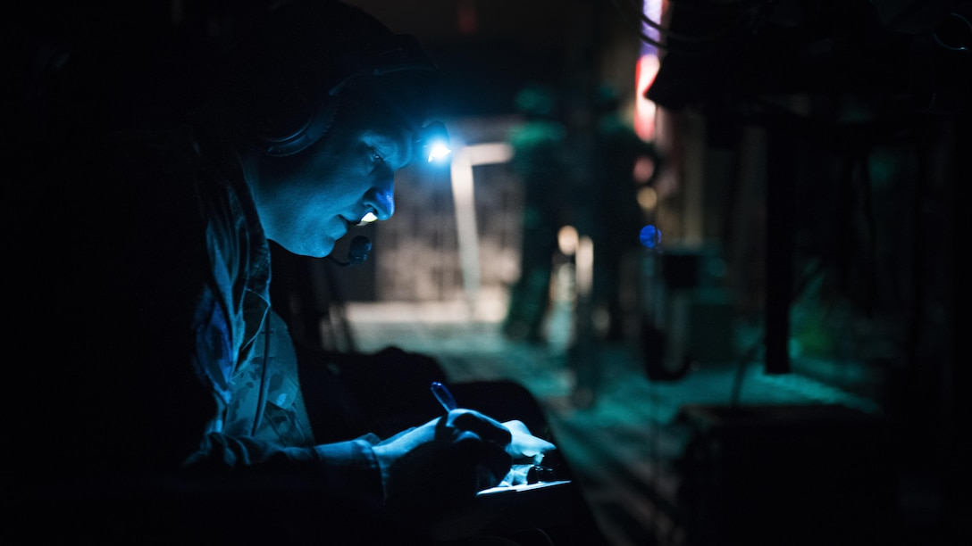 Capt. Alex Bedard, 455th Expeditionary Aeromedical Evacuation Squadron Critical Care Air Transport Team doctor, takes notes aboard a C-130J Hercules while transporting a patient from Kandahar Airfield to Bagram Airfield, Afghanistan, Feb. 22, 2017. Members of the 455th EAES transport critically ill or injured patients from austere locations throughout Afghanistan to receive a higher level of care. (U.S. Air Force photo by Staff Sgt. Katherine Spessa)