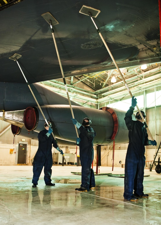 Airmen from the 5th Aircraft Maintenance Squadron wash a B-52H Stratofortress at Minot Air Force Base, N.D., Feb. 14, 2017. It takes the nine-Airman team two days and approximately 10 gallons of soap to wash each jet when it comes in for its routine wash every 120 days. (U.S. Air Force photo/Senior Airman J.T. Armstrong)