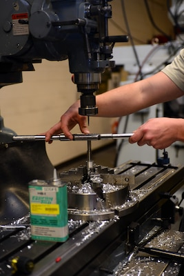 Airman 1st Class Herbert Schools, an aircraft metals technology apprentice assigned to the 28th Maintenance Squadron, threads equipment using the new VF5 Super Speed, and the UMC 750 Super Speed at Ellsworth Air Force Base, S.D., Feb. 22, 2017. Threading, the process of creating screw heads, has many different methods of being manufactured to include thread cutting and rolling allowing multiple options to create parts needed. (U.S. Air Force photo by Airman 1st Class Donald C. Knechtel)