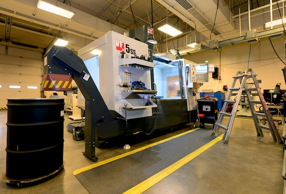 The 28th Maintenance Squadron fabrication shop received new Computer Numeric Controlled Milling equipment at Ellsworth Air Force Base, S.D., Feb. 22, 2017. The two new machines consist of a three axis drilling machine and a fifth axis machine that help the shop make products faster and more exact. (U.S. Air Force photo by Airman 1st Class Donald C. Knechtel)