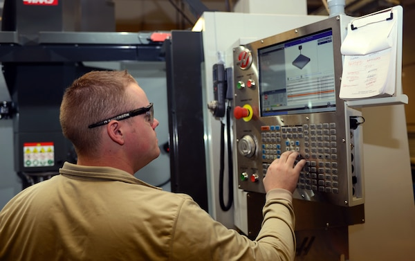 Senior Airman Drake Anderson, an aircraft metals technology journeyman assigned to the 28th Maintenance Squadron, inputs instructions into a VF5 Super Speed at Ellsworth Air Force Base, S.D., Feb. 22, 2017. The Super-Speed Vertical Machining Center, or the VF-5SS, allows the shop to speed up the manufacturing process and run more efficiently, as well as provides a way to test the tolerance of new aircraft parts. (U.S. Air Force photo by Airman 1st Class Donald C. Knechtel)