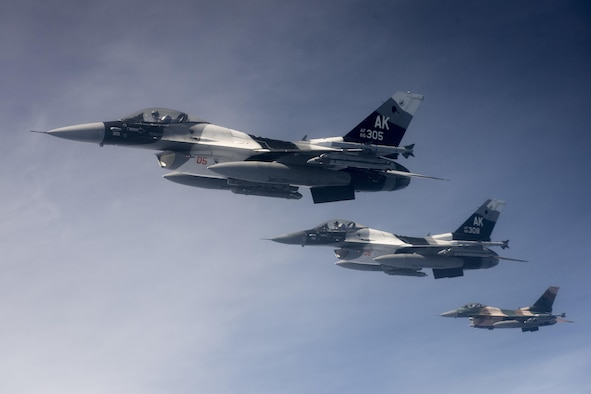 U.S. Air Force F-16 Fighting Falcons, assigned to the 18th Aggressor Squadron, fly in formation next to a 909th Air Refueling Squadron KC-135 Stratotanker March 1, 2017, off the coast of Guam. Twenty-two flying units from U.S. Pacific Command, Japan Air Self-Defense Force and the Royal Australian Air Force are in Andersen Air Force Base, Guam, to participate in annual exercise, Cope North. (U.S. Air Force photo/Senior Airman John Linzmeier)